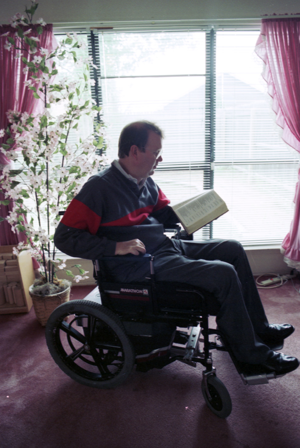 Rev. Robert Sorrels, a quadriplegic, has given up on finding a position as pastor for the Southern Baptist Convention; he takes time out from studying the computer for Bible reading.