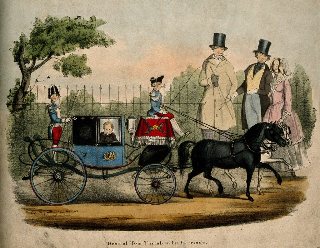 The image shows a color lithograph of a street scene from the nineteenth century, apparently. It shows a man with dwarfism in a miniature carriage on the street.