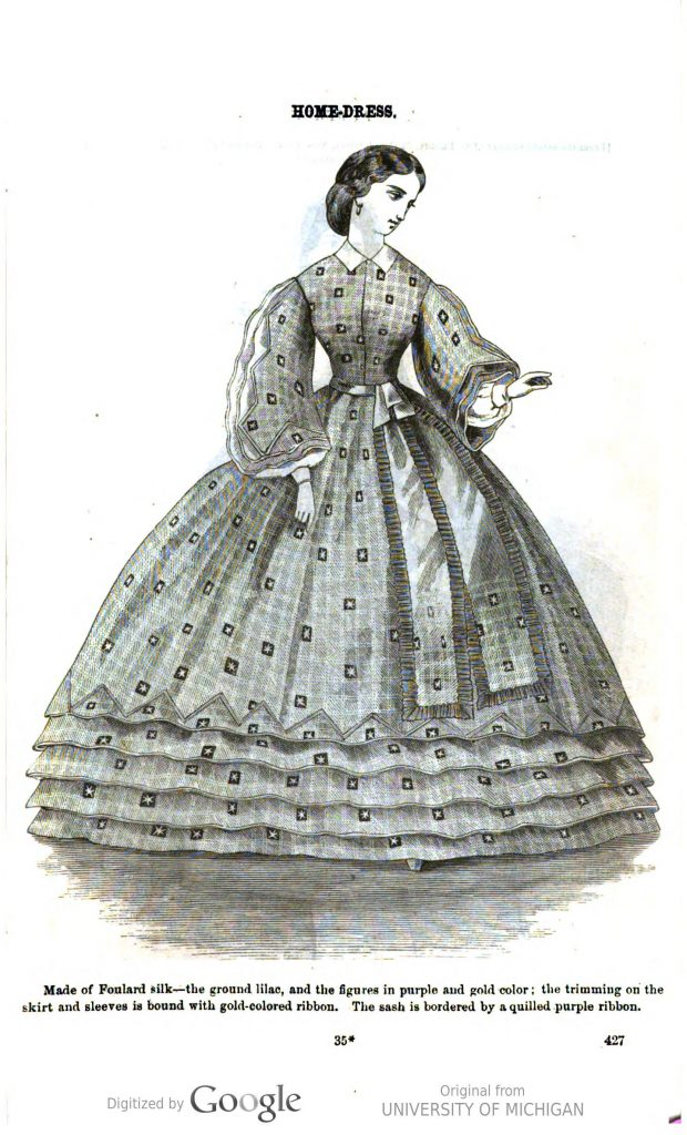 "This is a black and white digitized magazine page depicting an illustrated likeness of a woman wearing a dress with long sleeves and a skirt to the floor. The woman is looking off to her left, and her left hand is slightly raised. The plate reads: ""HOME-DRESS/Made of Foulard silk—the ground lilac, and the figures in purple and gold color; the trimming on the skirt and sleeves is bound with gold-colored ribbon. The sash is bordered by a quilled purple ribbon."